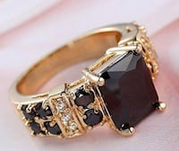 gold-colored and black gemstone ring Malibu, 90265