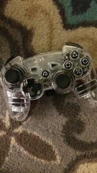 gray and black Sony PS3 controller