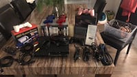 Black sony ps3 slim console with controller and game cases Saint-Hippolyte