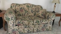 green, red, and cream floral loveseat Orlando, 32824