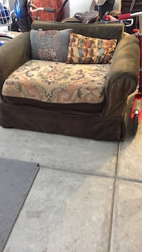 Black and brown floral sofa chair