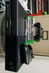 black xbox one console with game cases Sunnyvale