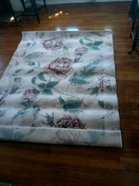 white, green, and purple floral textile