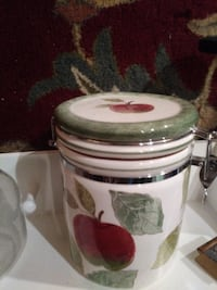 white, red, and green apple printed ceramic canister