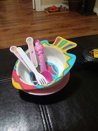 white yellow teal and red fish shape plastic bowl with plastic fork and spoon Delta, V4C 1X9