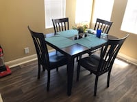 rectangular black wooden table with four chairs dining set Las Vegas, 89108