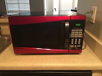 Black and red microwave with best offer Lithia Springs