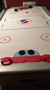White, blue, red, and black air hockey table Kamloops, V0E 2A0