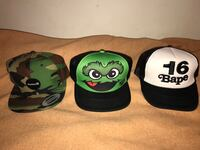 two black and green fitted caps San Gabriel