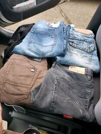 4 pairs of Jean's. the brown pair are men's long shorts (capris)  Edmonton, T5B 3R8