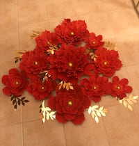 Red coloured paper flowers.