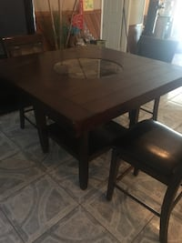 rectangular brown wooden table with four chairs dining set Houston, 77057