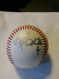 white and red baseball with signature Baltimore, 21212