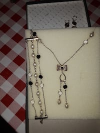 silver-colored chain necklace set