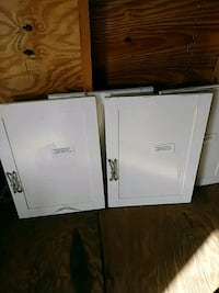 two white wooden 2-door cabinets Dover, 33527