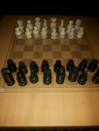 Marble hand carved chess pieces with glass board