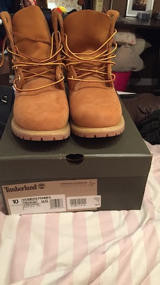pair of brown leather Timberland work boots with box