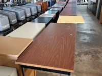 Assortment of office desks, prices vary from $125