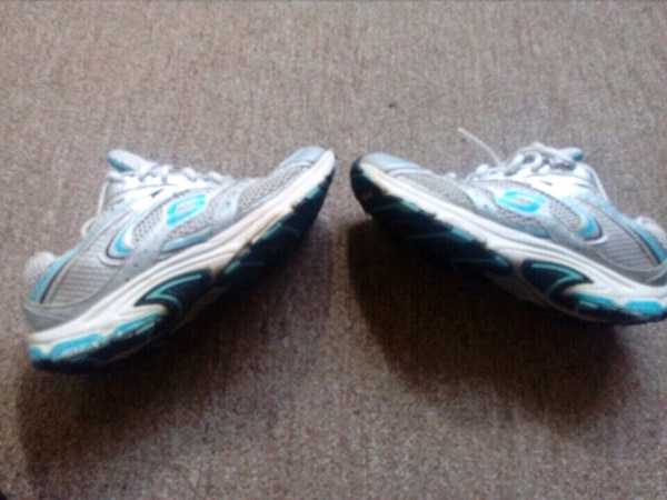 pair of white-and-blue running shoes