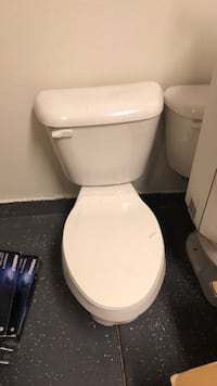 white ceramic toilet bowl with cistern 2239 mi