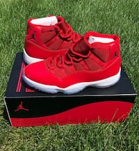 pair of red Air Jordan 11's with box 1906 mi