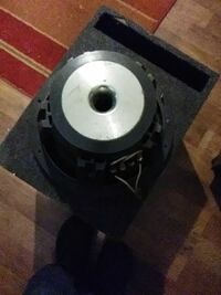 gray and black subwoofer with enclosure