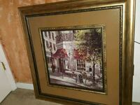 brown wooden framed painting of house Charlotte, 28208