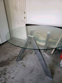 Glass top breakfast table with steel legs