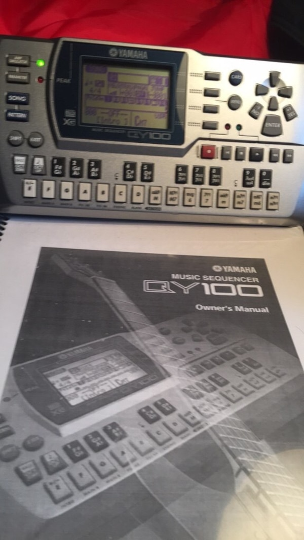 QY100 Yamaha Music Sequencer comes with power supply, case and manual