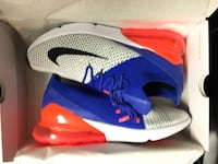 pair of blue-and-red Nike basketball shoes Louisville