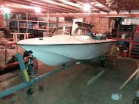 white and blue motor boat Newaygo, 49337