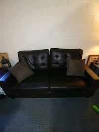 Sofa and loveseat and 2 black side tables
