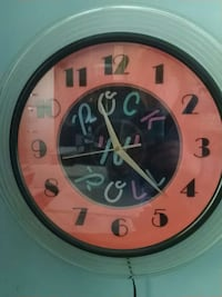 Rock and roll clock.  Neon Beltsville, 20705