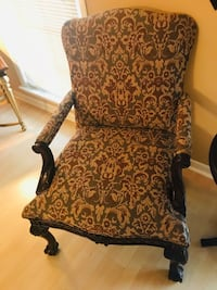 Accent chair with a bronze, taupe, and cream pattern with a timeless wooden frame! Add to any room of choice! New Orleans