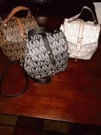 two brown and white leather handbags Lancaster, 93535