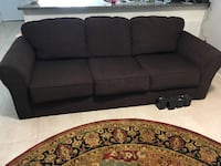 3-seat brown Serta couch with grey Sure-fit cover. Dunedin, 34698