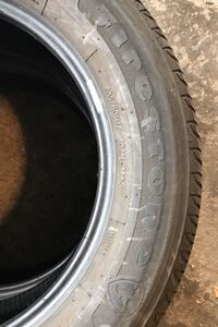 A set of 2 Firestone Champion Tires