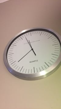 round silver analog wall clock