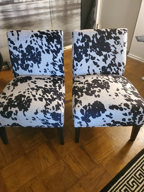 Two cow print chairs 139985a6-2b7d-4318-999c-9ae9a4af8672