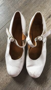 pair of white leather peep-toe heeled shoes