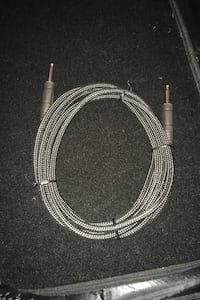 Braided guitar cable. Long. Brand new.