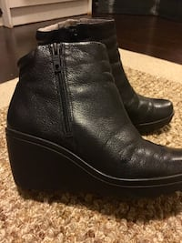 Pair of black leather side-zip booties North Vancouver, V7M