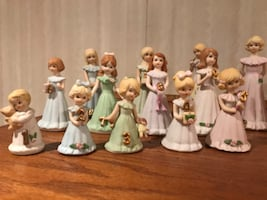 Enesco growing up porcelain figurines