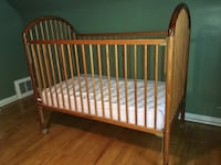 baby's brown wooden crib Montreal, H2E
