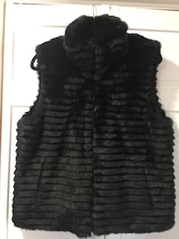 Black fur reversible vest. Size large Fall River