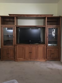 flat screen television with brown wooden TV hutch Ferndale, 48220