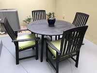 round brown wooden table with four chairs dining set New Port Richey, 34655