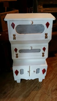 white wooden side table with drawers