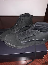 Pair of black vans old skool high-top sneakers