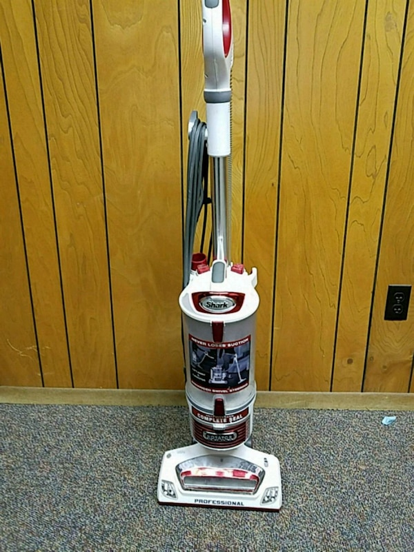 white and pink Shark upright vacuum cleaner